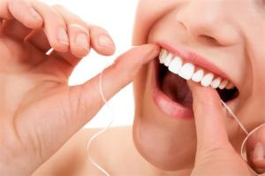 simple flossing steps, omaha cosmetic dentist, dr. Zuerlein